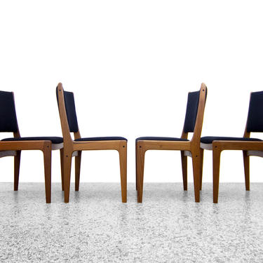 Johannes Andersen Teak Dining Chairs Upholstered in Black Boucle - Set of 4 by JefferyStuart