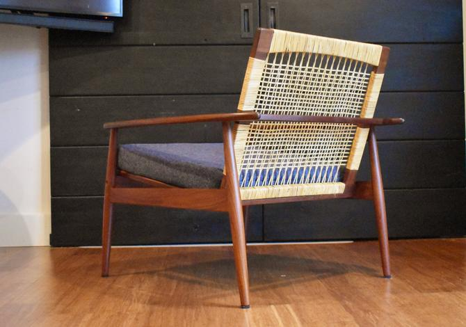 Hans Olsen for Juul Kristiansen cane-back lounge chair, circa 1960s by MidCenturyClever