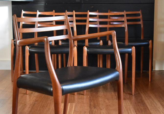 Six Danish teak Niels Moller 78/62 dining chairs w/black faux leather (five armless, one captains) by MidCenturyClever