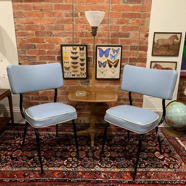 Retro vinyl chairs and table lamp