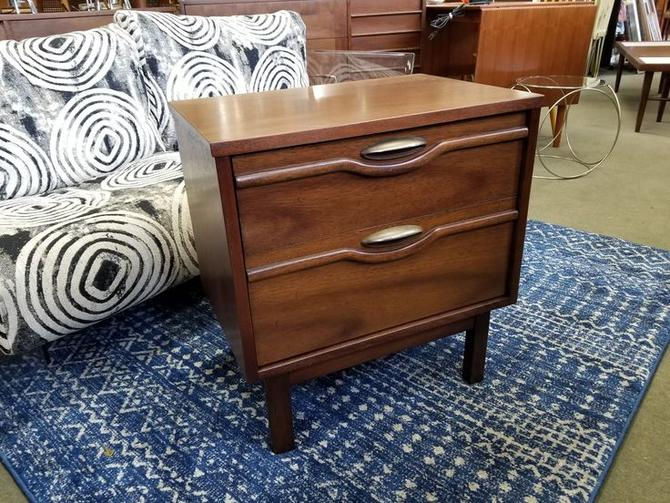 Mid-Century Modern nightstand with sculpted fronts