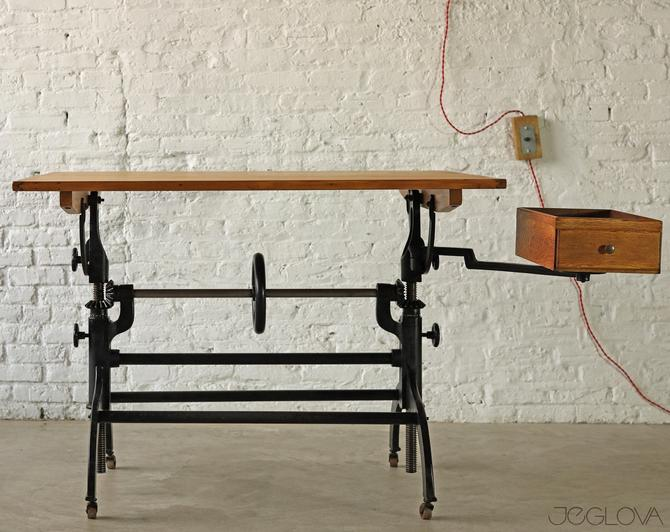 rare vintage industrial cast iron base drafting table by Hamilton MFG Co complete with tool box on swing-out arm and casters by jeglova