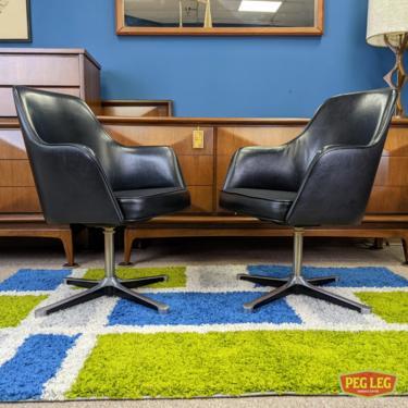 Pair of Mid-Century Modern swivel-base armchairs