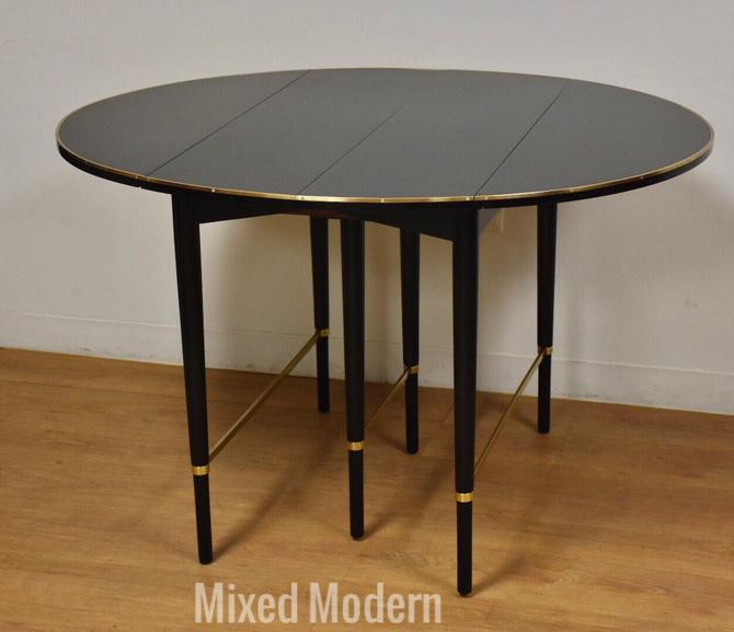 Paul Mccobb Black Lacquer and Brass Dining Table by mixedmodern1