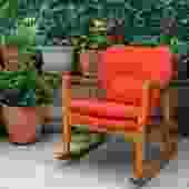 orange mid century modern style rocking chair with wooden frame