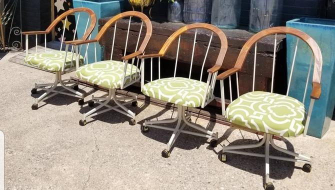 Set of 4 1970s, wood and metal on casters, dining chairs.