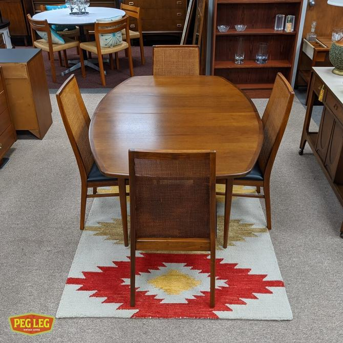 Walnut dining table from the 'Esprit' collection by Dillingham