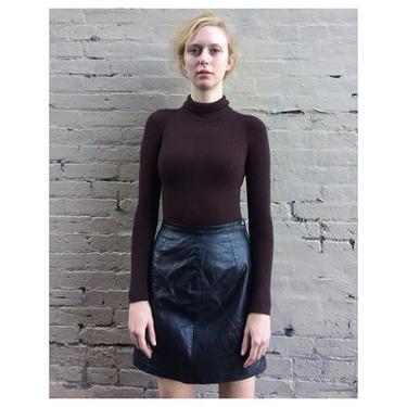 Fall essentials 1980s leather skirt + 1960s Danskin new old stock turtleneck bodysuit sz L worn by Betsy +much more black leather picks We are open til 8 today!#meepsdc #vintagebodysuit
