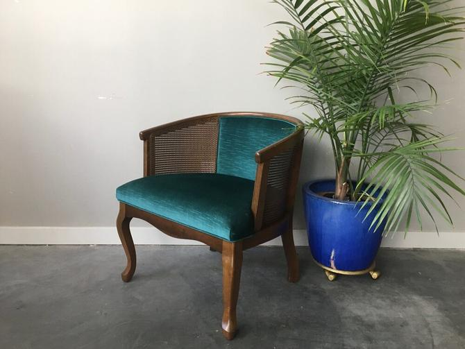 vintage cane barrel chair in teal.