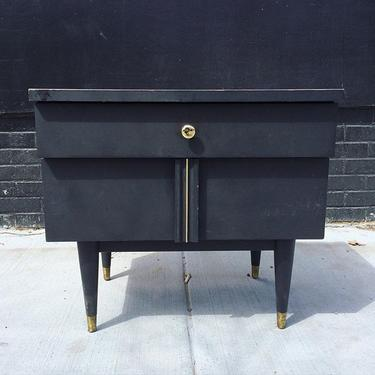 Midcentury mod end table or night stand. Two drawers, fluted and brass detail on the lower. Brass capped peg legs. $60. Check out one of the city's best jazz and