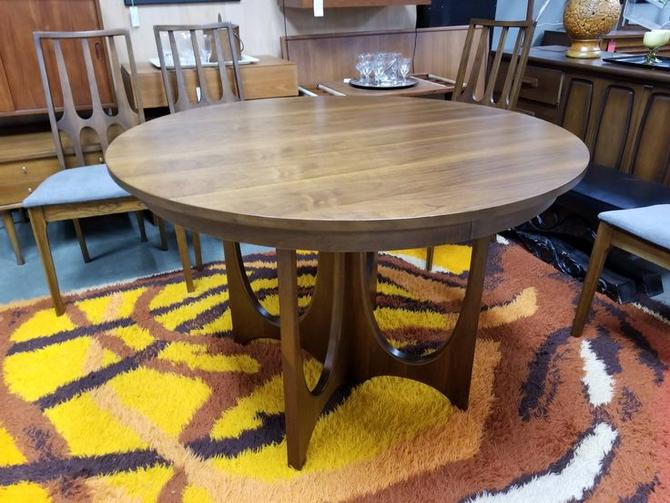 Mid-Century Modern round walnut dining table from the Brasilia collection  by Broyhill