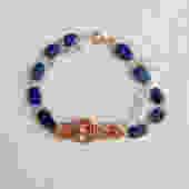Lucy Assemblage Bracelet [lapis, quartz, vintage brass stamping] by nonasuch