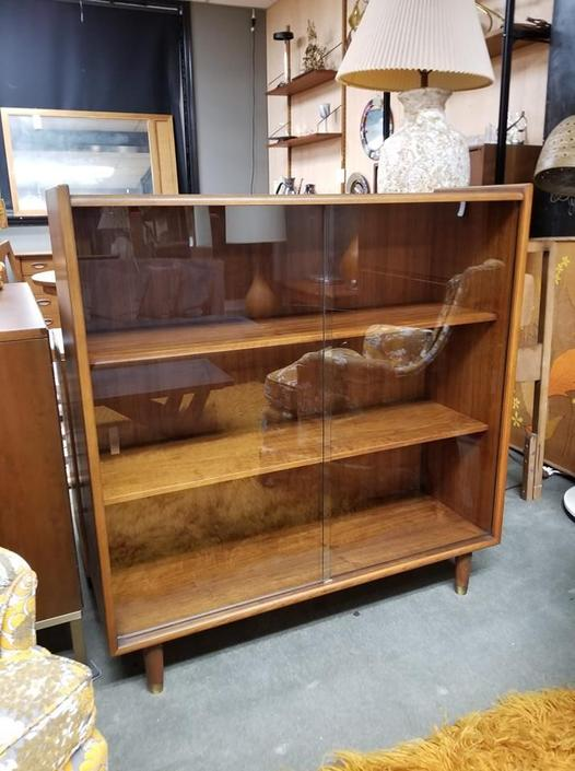 Mid-Century Modern walnut bookcase with sliding glass doors
