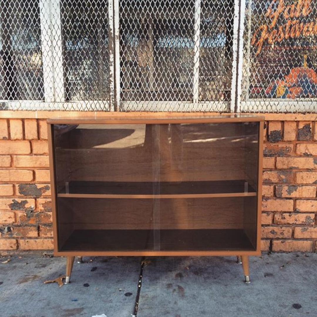 Midcentury modern style cabinet with sliding glass doors ...