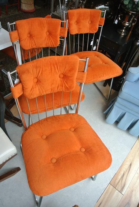 Orange and chrome chairs. $35/each