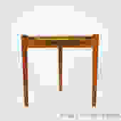 Small teak side table with a reversible top