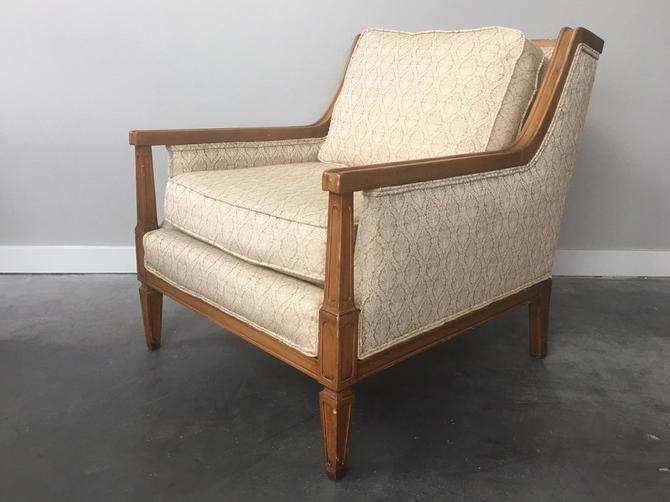 vintage mid century modern gold lounge chair.
