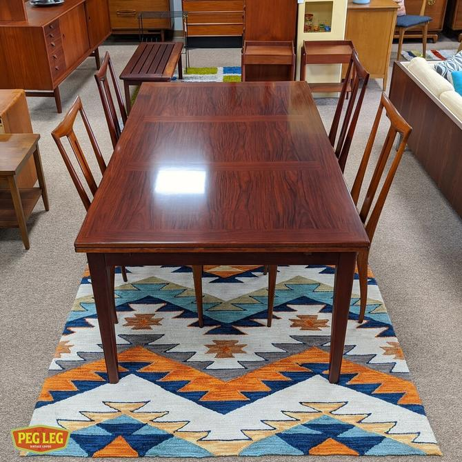 Large Danish Modern rosewood draw-leaf dining table