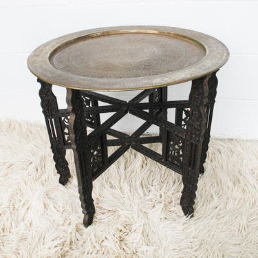 Vintage Mid-Century Round Brass Coffee Table with Folding Base with Carved Detail by PortlandRevibe