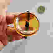Large Apple Juice Bakelite Button on Woven Band as Bracelet by LegendaryBeast