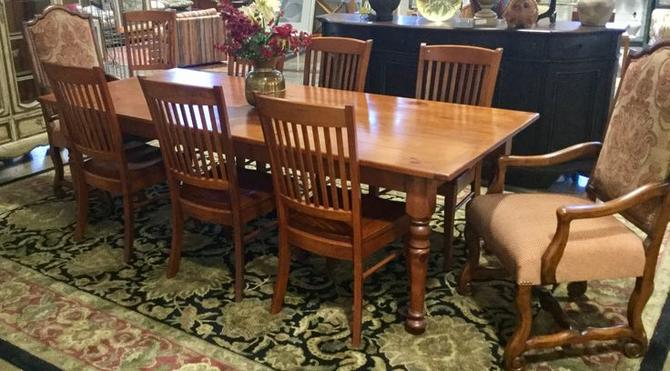 Unique wooden table and chairs, table made from reclaimed wood from Camdon Yard Railway station. Asking for $1995.00 Available at Habitat for Humanity Restore Rockville
