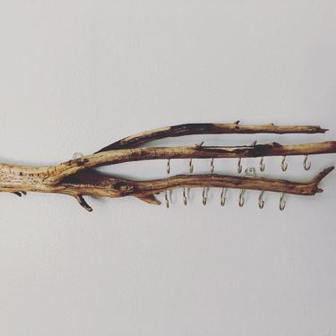 Driftwood jewelry organizer by emmaleejanedesign