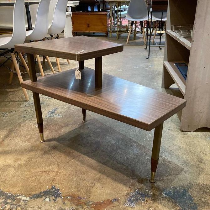 "Mid century laminate top step end table. Has metal legs. 29.5"" x 17"" x 15""/22.5"""