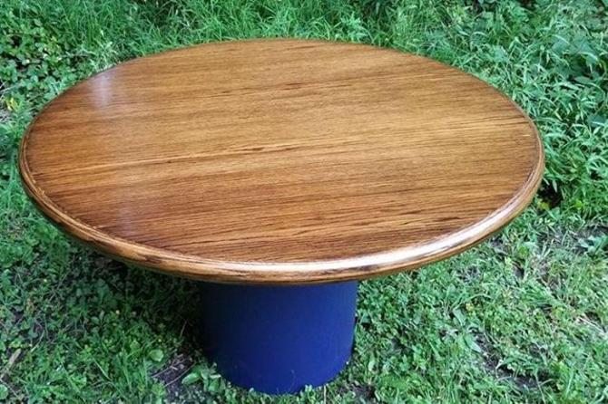 "Re-imagined circular dining table. 48"" diameter by 28"" height. $275"