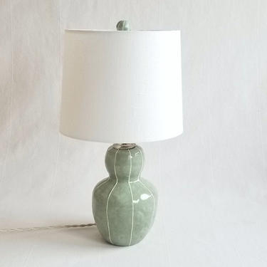Small ceramic lamp. Unique bedside table lighting is handmade, detailed with thin, white stripes. Interior home lighting by kRI kRI Studio by krikriceramics