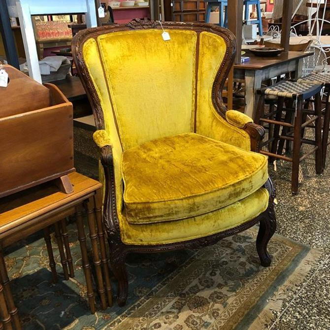 Canary yellow crushed velvet armchair