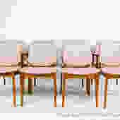 A set of 8 teak dining chairs