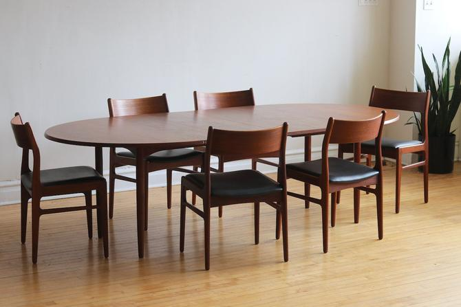 Mid Century Danish Modern Oval Dining Set by SharkGravy