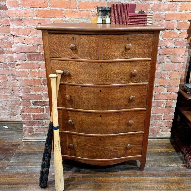 Antique tiger oak, bow front dresser