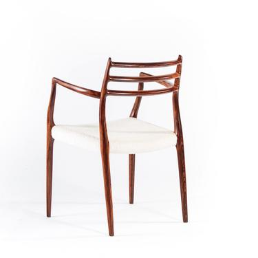 Model 62 Rosewood & Knoll Boucle Arm Chair by Niels Møller for J.L. Møllers, 1960s by ABTModern
