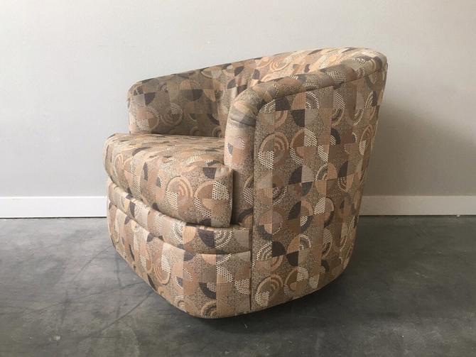 90s swivel barrel chair.