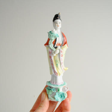 Vintage Japanese Porcelain Figurine of a Woman Holding a Lotus Flower by LittleDogVintage