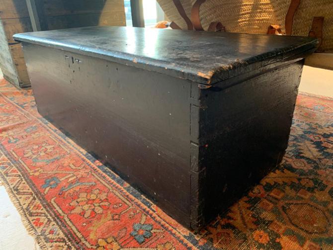 """Antique black blanket chest, 43.25"""" l x 17.5"""" d x 15"""" t, $145."""