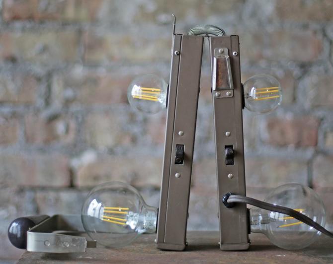 vintage cine-kodak 4-lamp folding movie light bar mountable directly into camera by jeglova