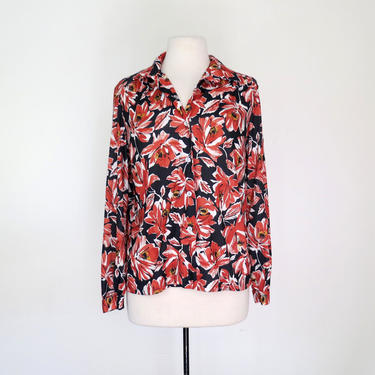 1970s polyester blouse with vibrant flowers by flutterandecho