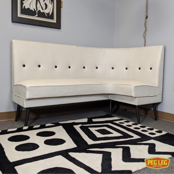 Mid-Century Modern vinyl banquette with tapered legs