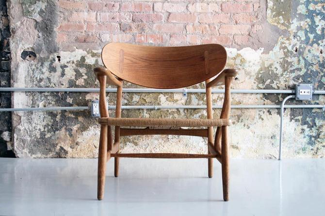 Vintage CH22 lounge chair in Oak by Hans Wegner for Carl Hansen & Son
