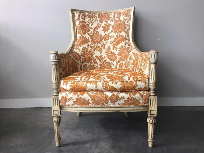 vintage orange floral high back chair.