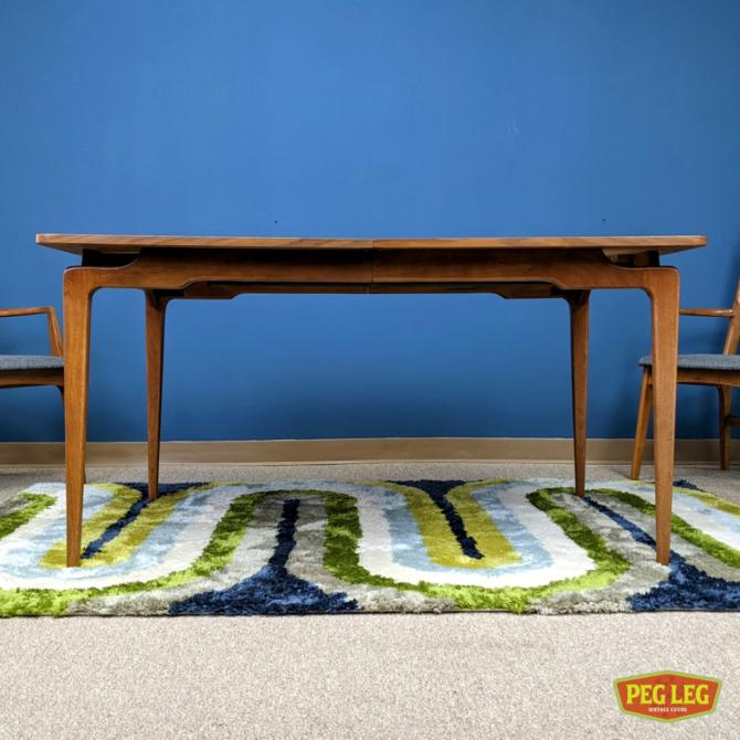 Mid-Century Modern walnut dining table with two large leaves