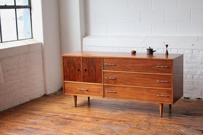 Restored Mid Century Modern Walnut Triple Dresser with Brass Pulls and Ebonized Tabs by NijiFurnishing