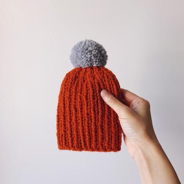 Little Minnows Hand Knit Baby Beanie Hat // Pumpkin with Gray Pompom by mammothandminnow