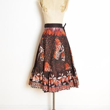 vintage 70s wrap skirt black batik print high waisted hippie boho cotton midi clothing by huncamuncavintage