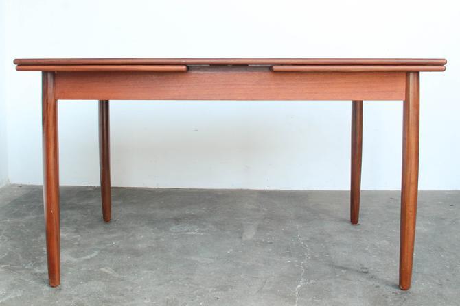 Danish Modern Rectangular Teak Wood Draw Leaf Dining Table by IridiumInteriors
