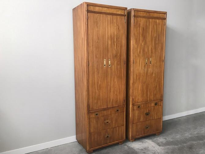 pair of vintage mid century Drexel Passage campaign nightstand tower cabinets.