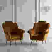 Pair of Italian Mid Century Lounge Chairs in the style of Osvaldo Borsani