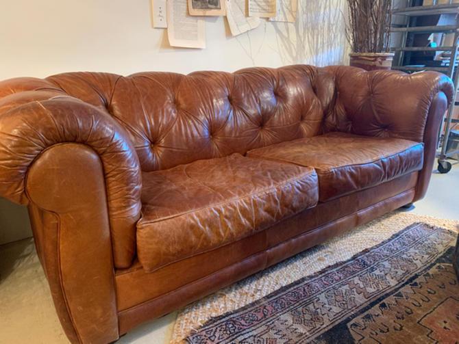"Vintage Chesterfield sofa, 7.5"" l x 40"" d x 30.5"" t, $1,195."